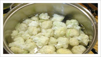 Break up the cauliflower into florets of about 1 in cubes, wash and place in a saucepan of cold salted water.