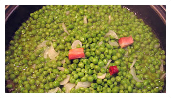 Add the peas and water enough to cover, and add salt and pepper